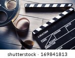 movie clapper and film reel on... | Shutterstock . vector #169841813