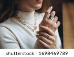 Woman's Hands Close Up Wearing...