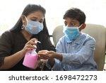 cautious mother wearing face... | Shutterstock . vector #1698472273