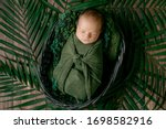 Little cute baby sleeps in a...
