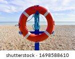 Bright Red Lifebuoy   On A Blue ...