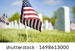 Small photo of Denver, Colorado, USA-May 26, 2019 - Small American Flags next to white marble gravestones at the Fort Logan National Cemetery on Memorial Day.