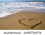 Heart On Sand On A Sunny Summer ...