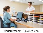 nurse and patient conversing at ... | Shutterstock . vector #169875926