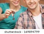 key of their brand new house.... | Shutterstock . vector #169894799