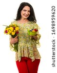Happy Woman Holding Flowers An...