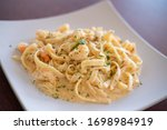 A Pasta Alfredo With Shrimps On ...