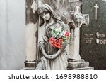 Sculpture Of A Woman With...