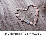 Small Stones On Wood Heart...