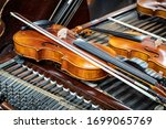 antique violin and violin bow... | Shutterstock . vector #1699065769