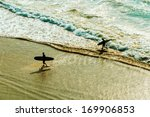 Two Surfers Going Back To The...