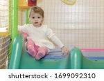 A Little Girl On A Children\'s...