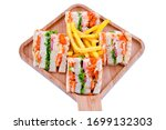 Small photo of Zinger Club Sandwich with french fries on wood base. Toasted bread, Zinger chicken, cheese slices, chili sauce and lettuce are layered in this zinger club sandwich.