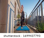 A Woman Practices Yoga On The...