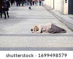 beggar woman beg for some money ...   Shutterstock . vector #1699498579