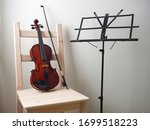 Violin In A Chair Under The...