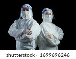 Doctor Wearing Ppe Suit And...