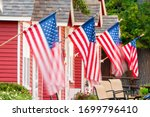 American flags fly at a resort with red cottages in Copper Harbor, MI.