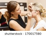 woman applying make up for a... | Shutterstock . vector #170017580