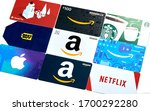 Small photo of Montreal, Canada - April 9, 2020: Different gift cards of many brands such as Amazon, Netflix, Xbox, Google Play, Best Buy, Spotify, Starbucks. A gift card is prepaid card of a store or service