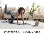 Small photo of Online Training. Fit Young Woman Excersising At Home, Watching Video Tutorial On Laptop