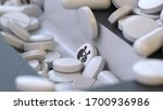 Many White Tablets With An...