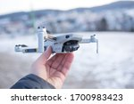 Kašperky, Czech republic - January 25, 2020: The smallest drone launched by the DJI company. A drone weighing only 249 g- DJI Mavic Mini. Ultra light drone in hand ready to take-off. - stock photo