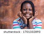 Head Shot Of Smiling Nigerian...