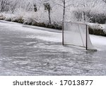 Natural ice ring and hockey net - stock photo