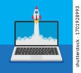 open laptop with rocket launch ... | Shutterstock .eps vector #1701928993