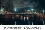Canal With Bridge In Night...