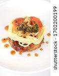 spaghetti bolognese on a white... | Shutterstock . vector #1702200199