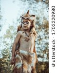 Small photo of Angry caveman, manly boy. Prehistoric tribal boy outdoors on nature. Young shaggy and dirty savage, warrior and hunter. Primitive ice age man in animal skin. Reconstruction of Neanderthal and cro