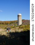 Old Truck And Grain Silo At...