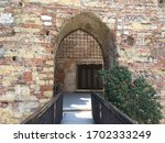 Arched walkway through to castelvecchio bridge in the prominent, rebuilt, red brick castelvecchio in Verona, northern Italy. Iconic, gothic architecture, with the Adige river running below.