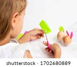 A Child Decorates Easter Eggs....