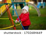 Cute Toddler Girl Having Fun O...
