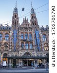 Small photo of AMSTERDAM, NETHERLANDS - AUGUST 22, 2019: Magna Plaza Shopping Center. Magna Plaza, formerly known as Amsterdam Main Post Office, is a monument part of Dutch Top 100 heritage sites.