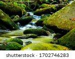 Water Cascading Through Rocks...