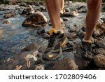 A Man In Trekking Shoes Crosses ...