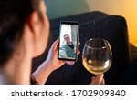 Small photo of Woman Calling By Video Chat Her Friend And Drinking Wine With Him. Online Date, Meeting With Friend. Stay Home. Social Distance and Isolation