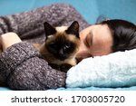 woman sleeping in bed with her... | Shutterstock . vector #1703005720
