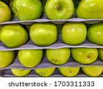 Granny Smith Apples Stacked On...