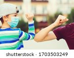 Small photo of Family greeting style with elbows. Coronavirus quarantine. Social distancing concept. Family, lifestyle, new style of greetings. Kid and father greeting with elbows outdoors. Coronavirus prevention.