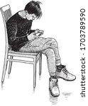 sketch of teen boy sitting on... | Shutterstock .eps vector #1703789590