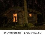 Log Cabin In The Forest At...