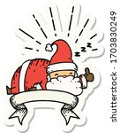 sticker of a tattoo style santa ... | Shutterstock .eps vector #1703830249