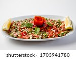 Small photo of kebab salad. They are indispensable flavors of Turkish cuisines. Especially with tomato and hot pepper sauce. Shepherd's salad, tomato salad, and cigkofte are great presentations.