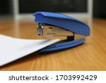 Photo of blue stapler put on...