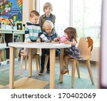young boys and girl using... | Shutterstock . vector #170402069